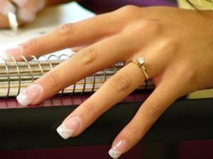 Engagement ring on ladies finger